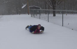 Linda on sled in SNOW!